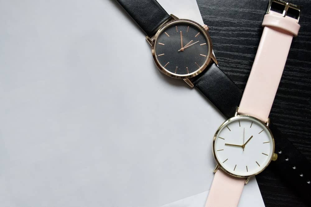 Black and pink analog watches