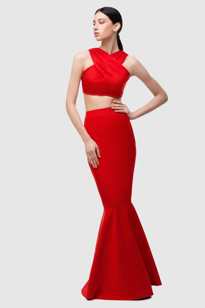 Woman wearing a red mermaid gown.