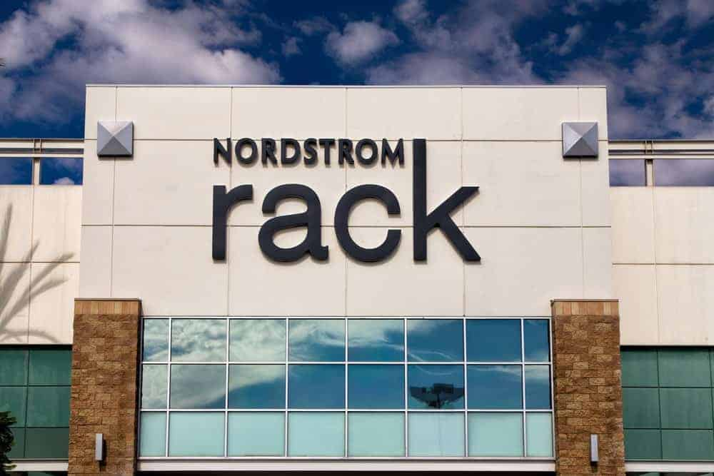 Focused look at the name of the Nordstrom Rack store on the upper exterior wall.