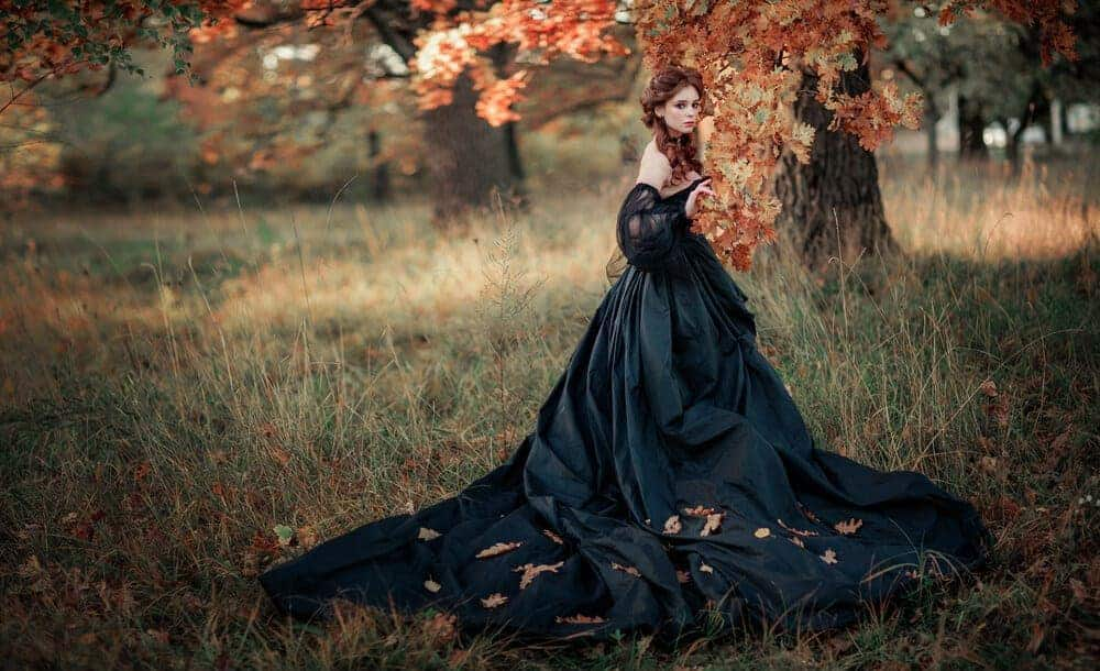 A woman wearing a black gothic gown.