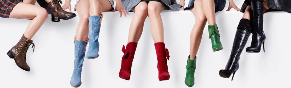 Girls sitting with shoes of different colors.