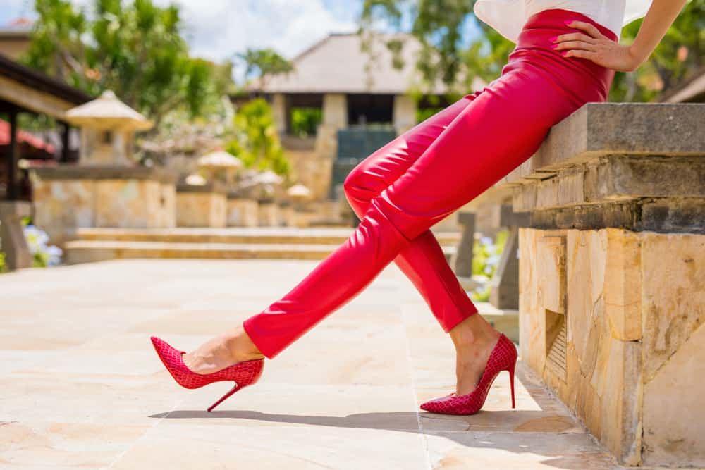 Red leather pants and matching high heel shoes