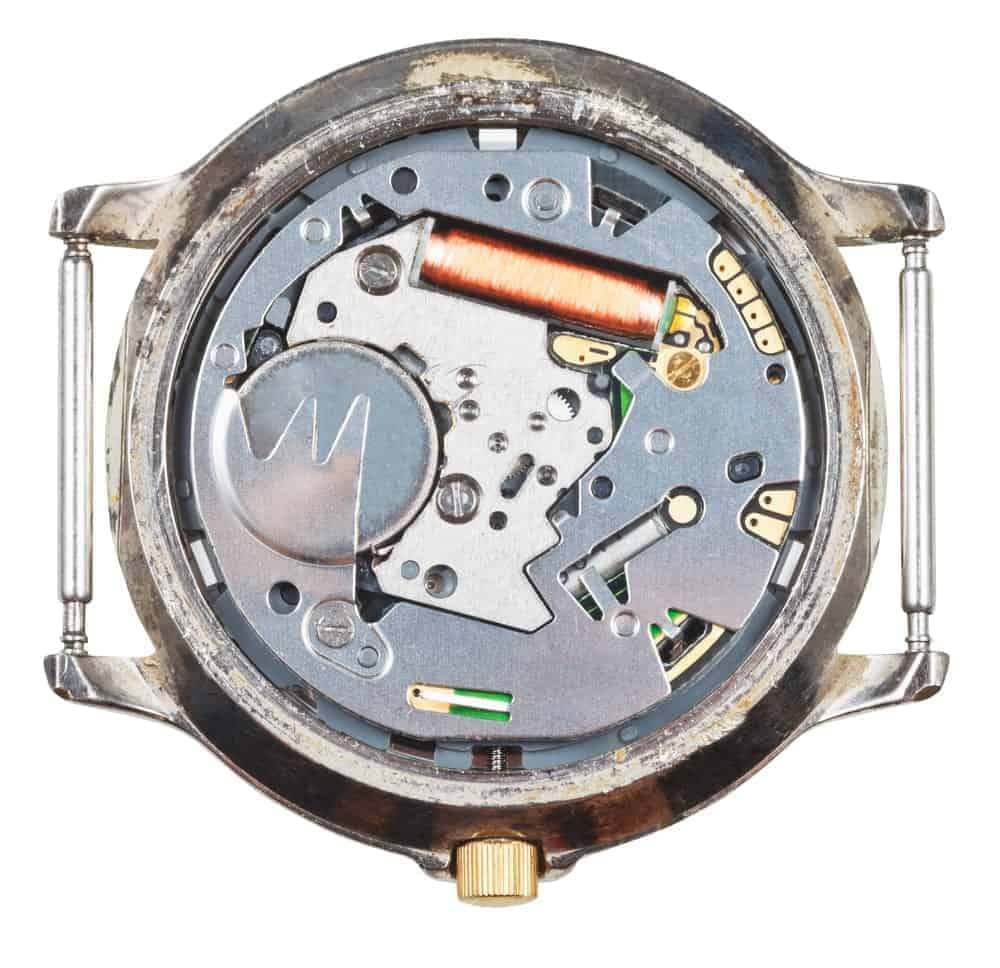 Quartz wristwatch movement in an old watch.