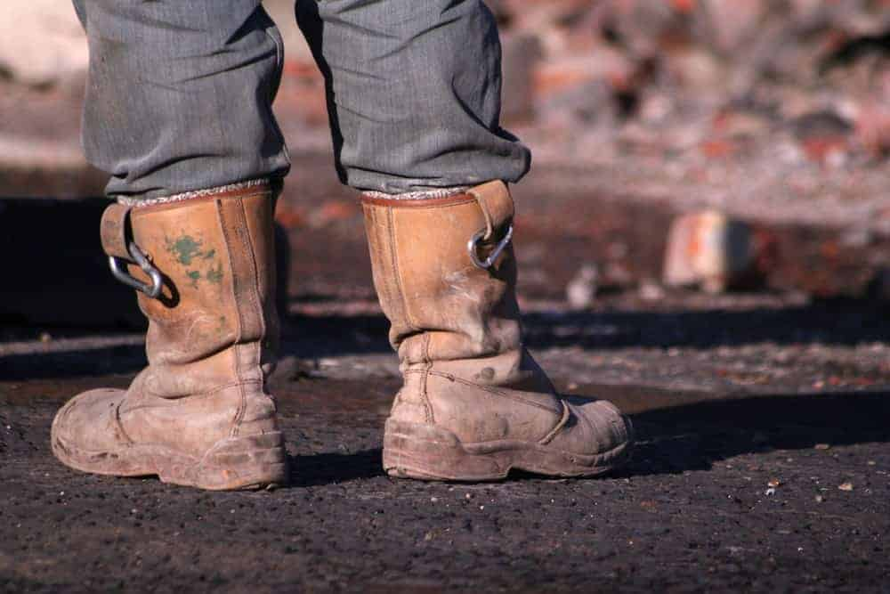 A workman wearing rigger boots.