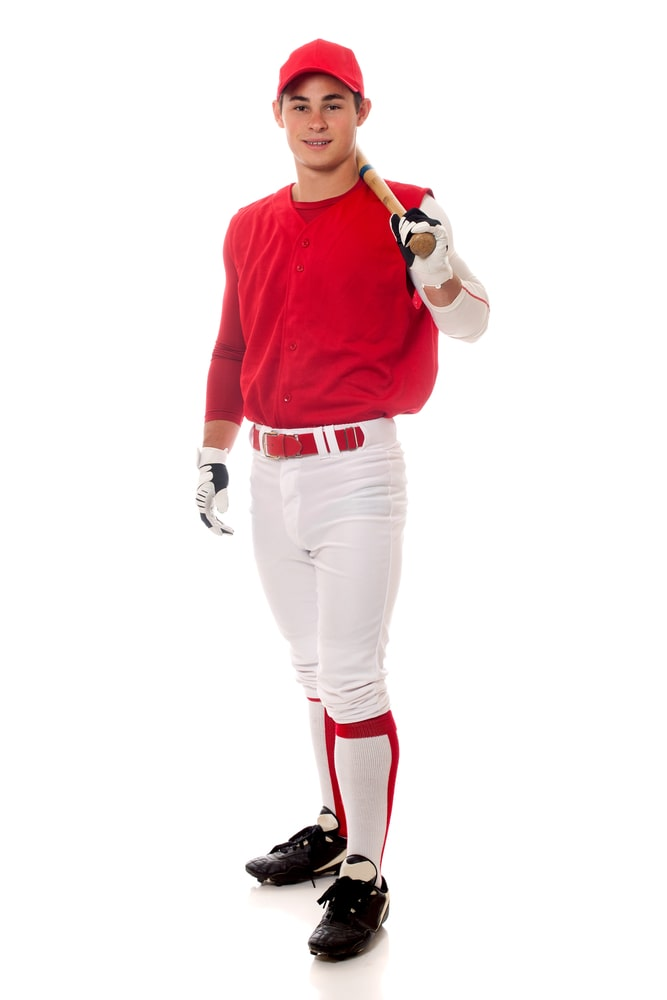 Baseball player with stirrup socks (baseball socks) standing on a white background