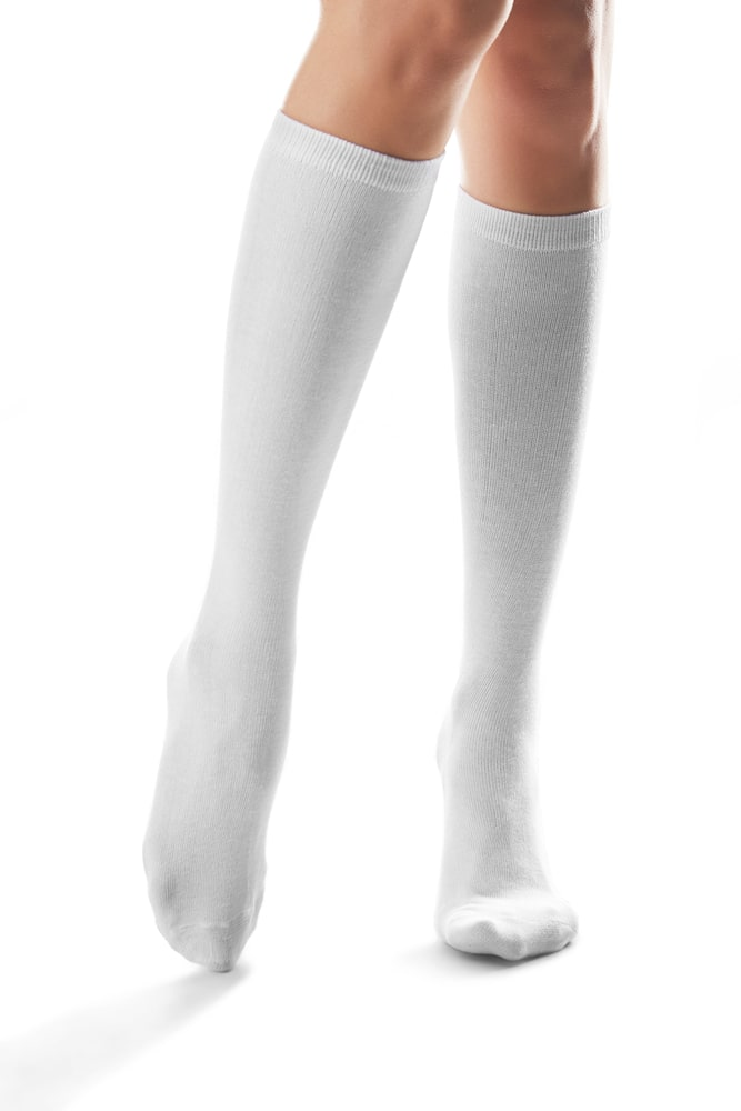 Person wearing white mid calf socks on a white background