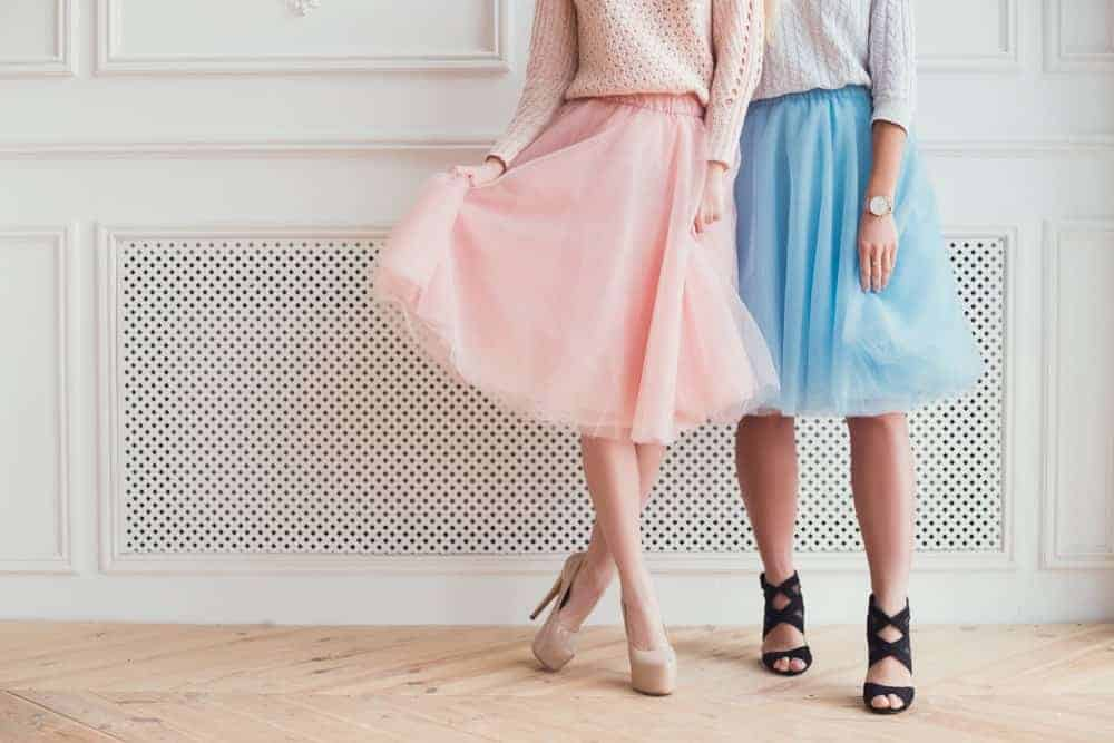 Two girls in tulle skirts and heels.