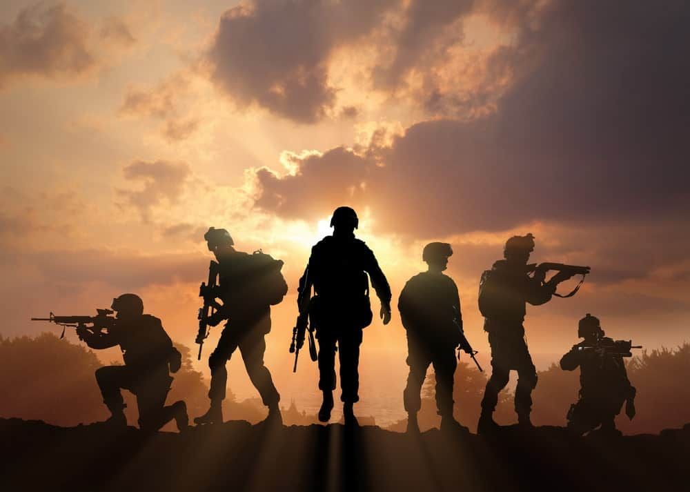 Military silhouettes on sunset.