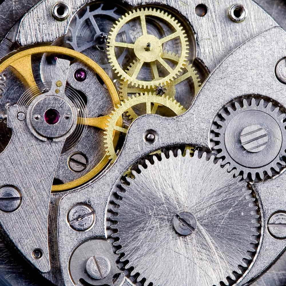 Closeup of a clockwork with gears, spring, steel, and brass.