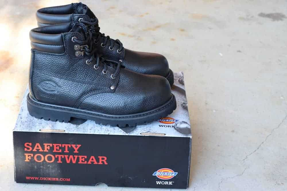 Dickies steel toe work boots sitting on a box.