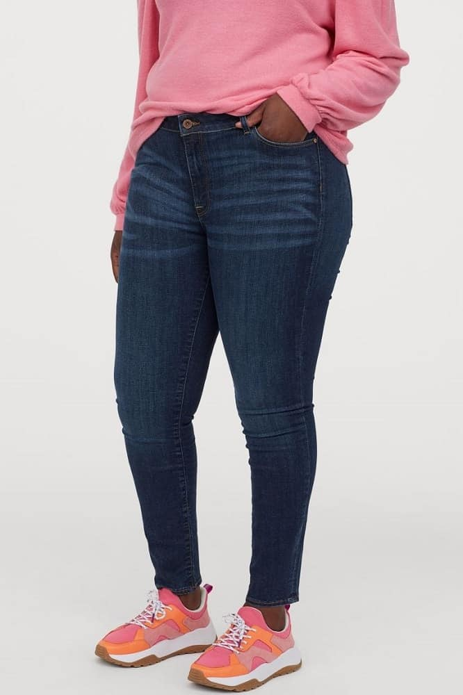 A woman wearing a pair of H&M jeans.