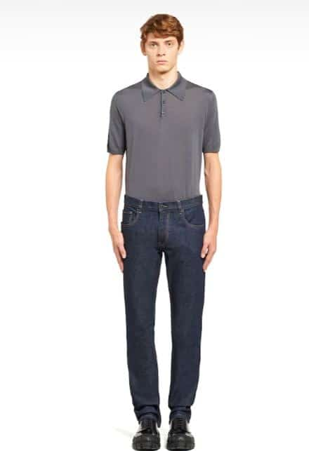 A man wearing a pair of Prada jeans.