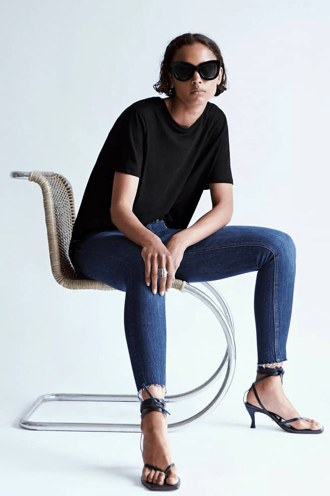 A woman wearing a pair of Zara skinny blue jeans.