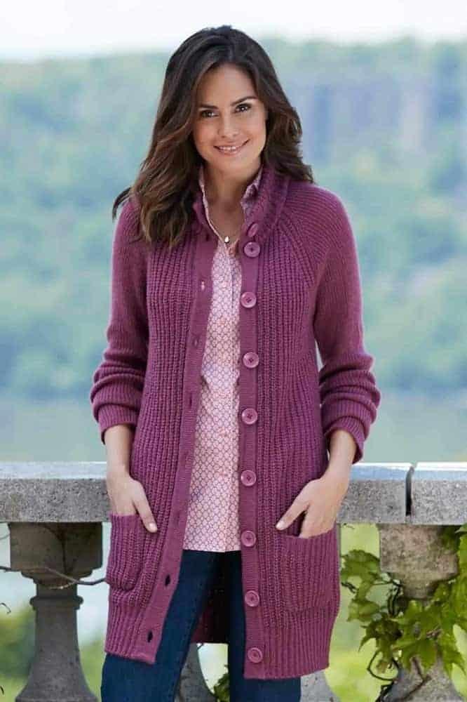 A woman wearing a purple tunic cardigan.