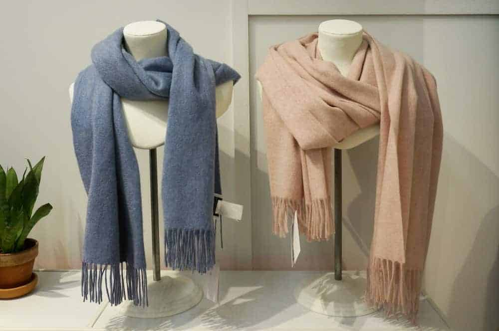 A couple of shawls on display in a shop.
