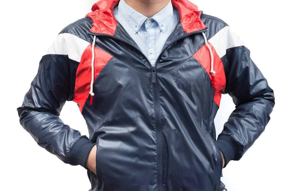 A man wearing a windbreaker jacket.