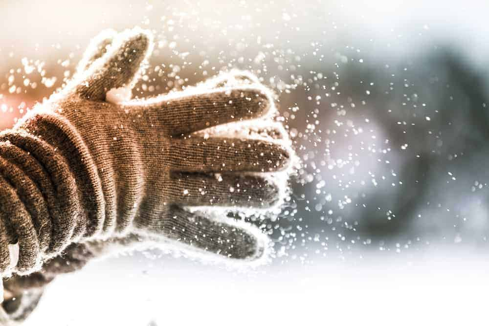 A close look at wool gloves in snow.