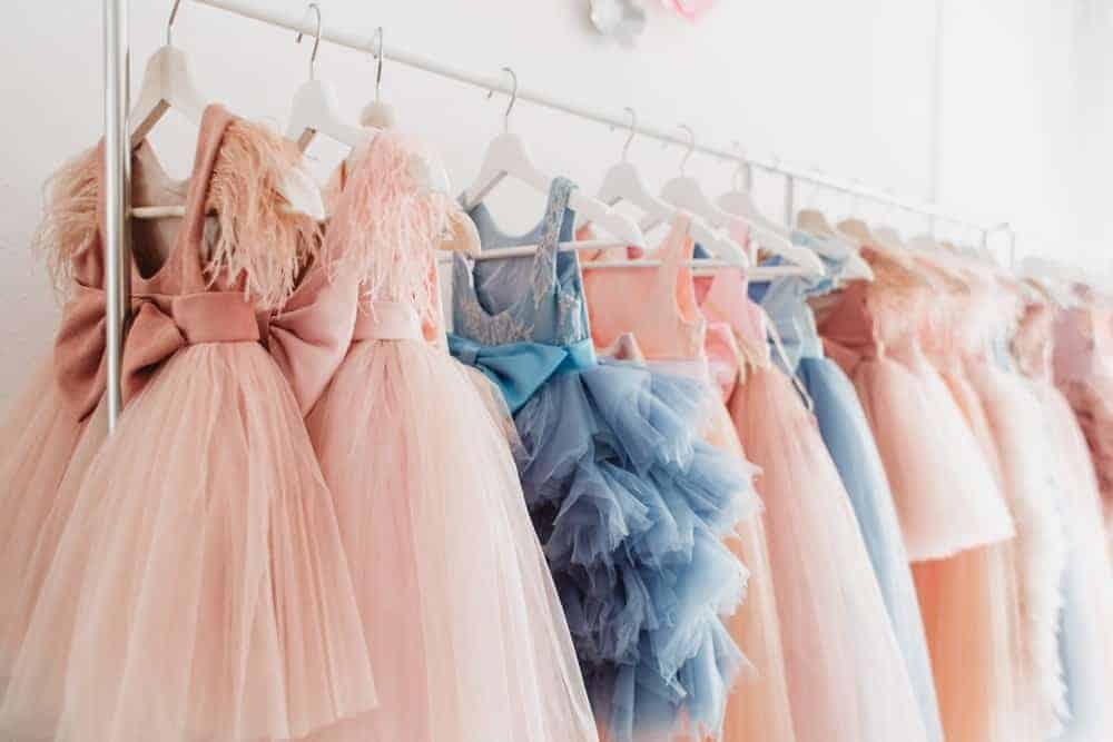 Lovely and colorful gowns hanging on a rack.