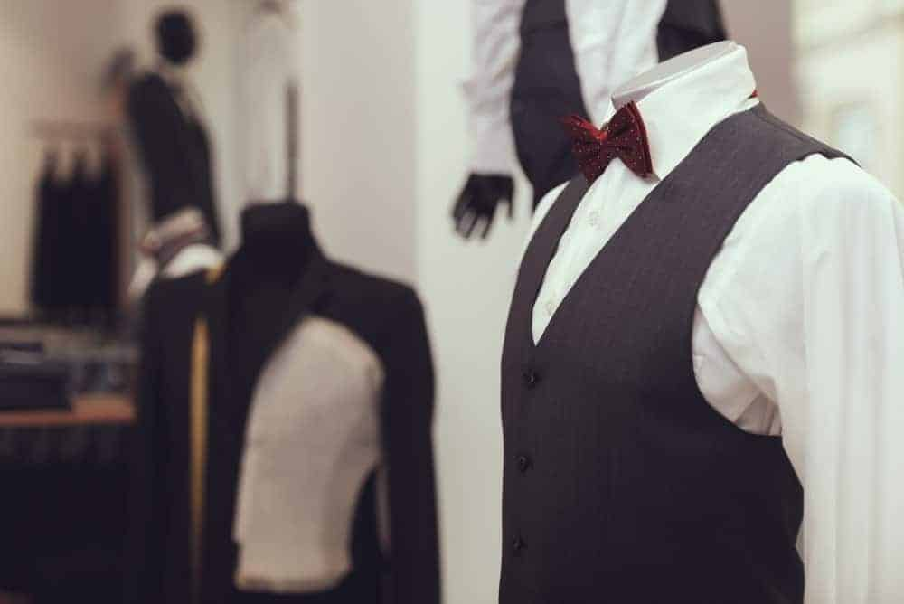A mannequin in a dress shirt, waistcoat, and tie.