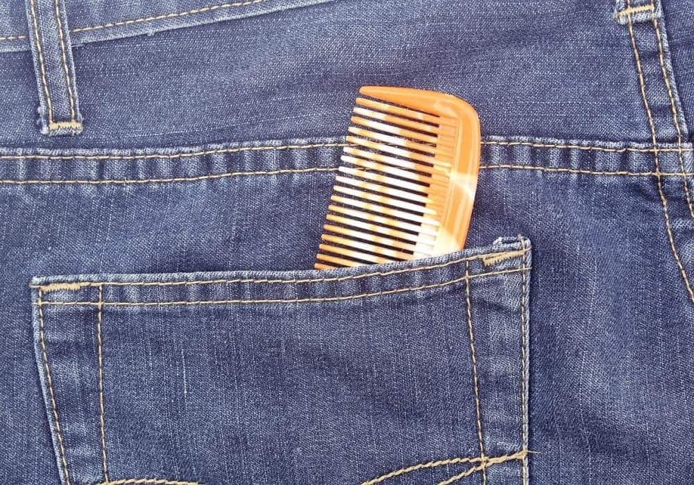 A small patterned pocket comb in a denim pocket.