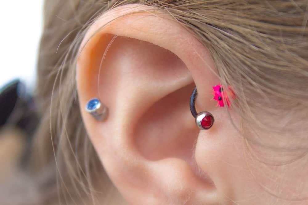 A close look at a woman's pierced forward helix.