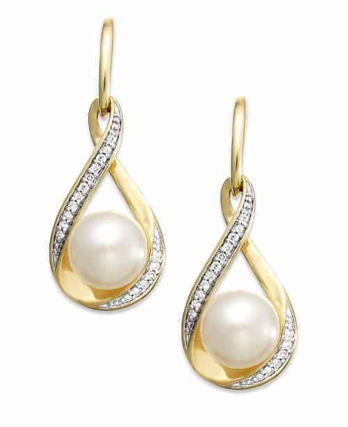 A pair of drop earrings with pearl and diamonds.
