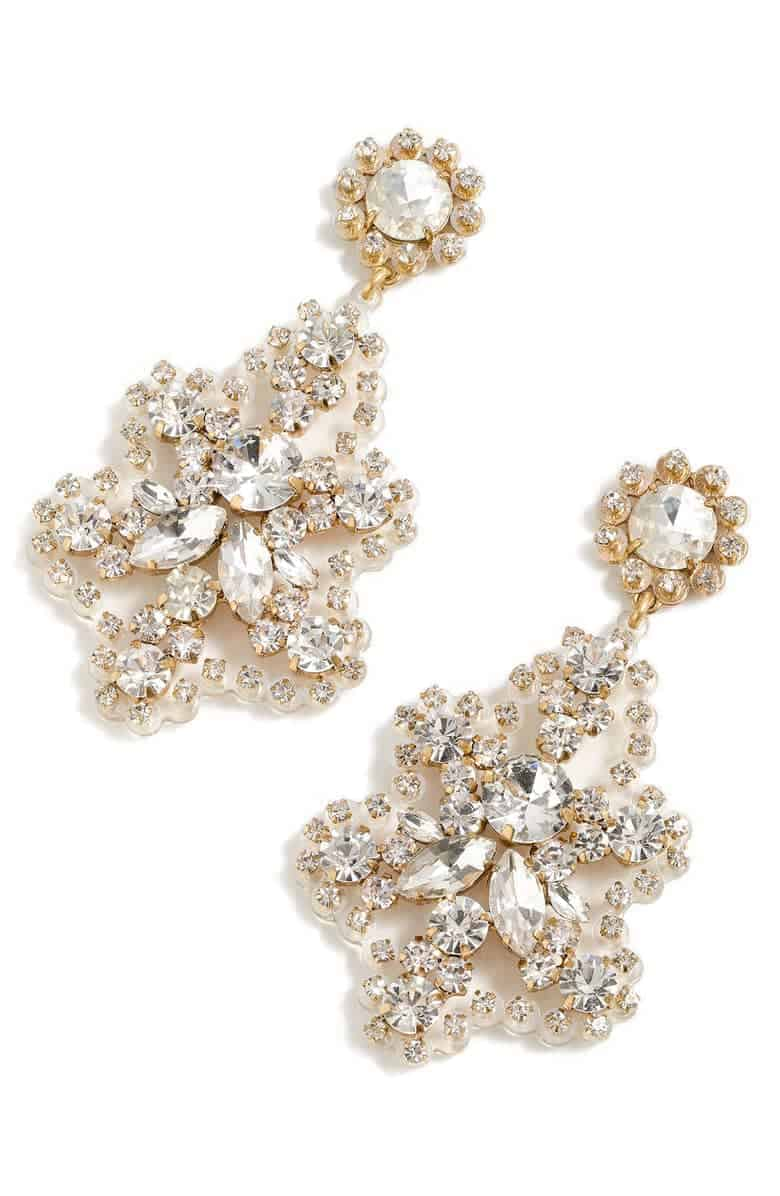 A pair of chandelier earrings with gold and diamonds.
