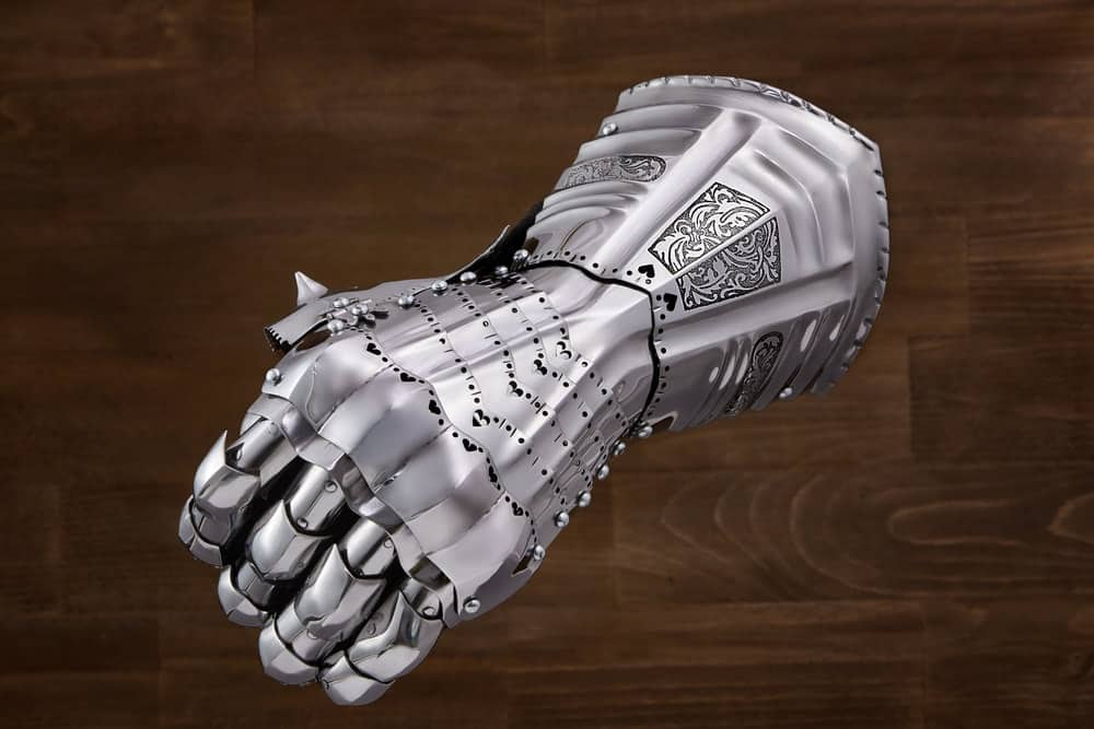 A close look at a steel armored glove.