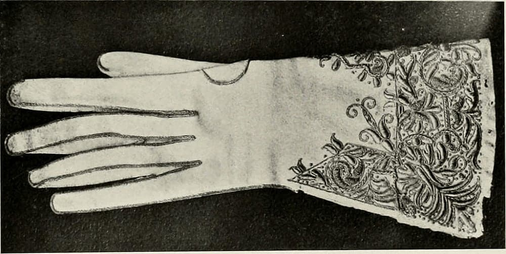 A close look at an embroidered glove.