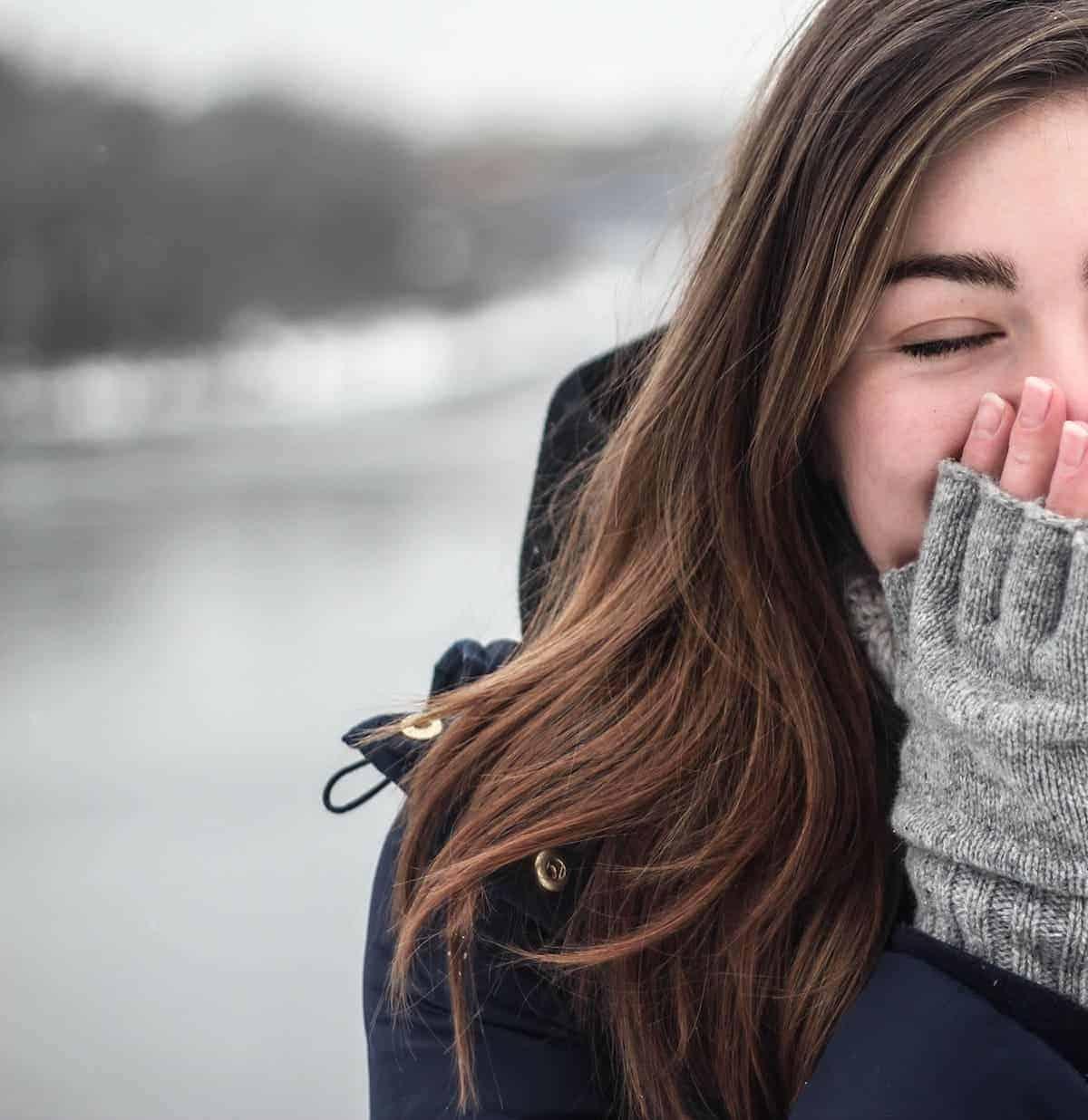 A woman wearing fingerless gloves.
