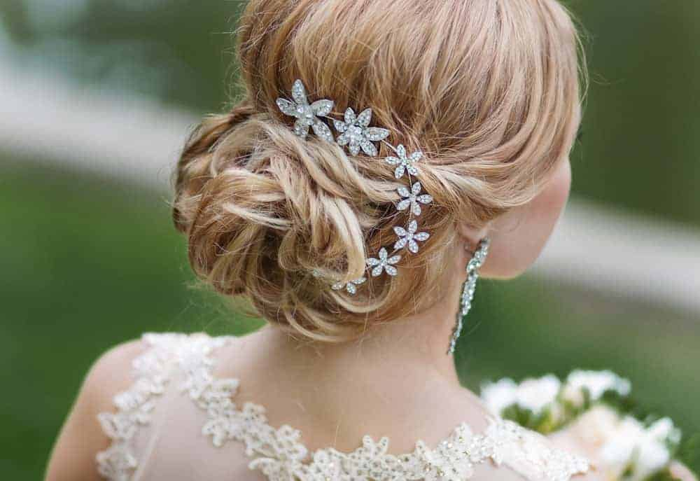 Back view of a bride wearing a stylish hair accessory.