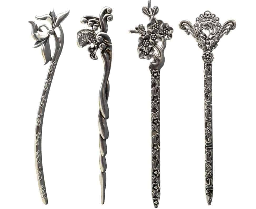 A set of decorative metal hairpins.