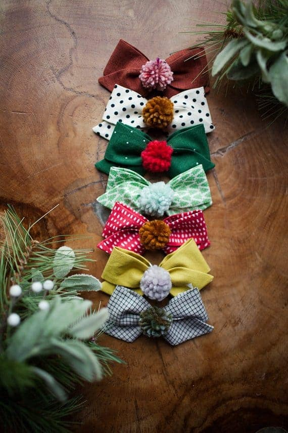A set of colorful and patterned pom-pom bows.
