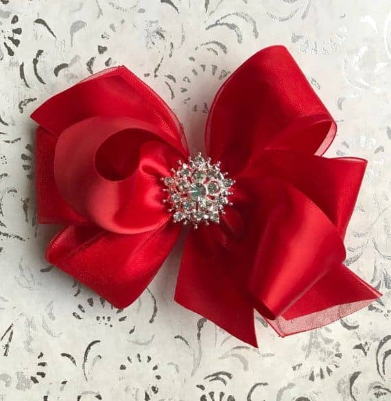 A close look at a red bow made from organza.