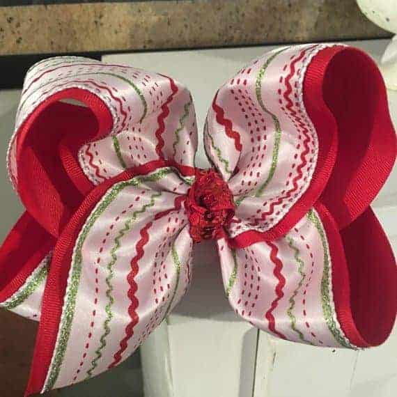 A black and red patterned bow made of ric-rac.