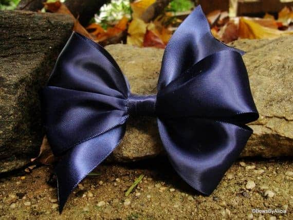 A close look at a black satin bow.