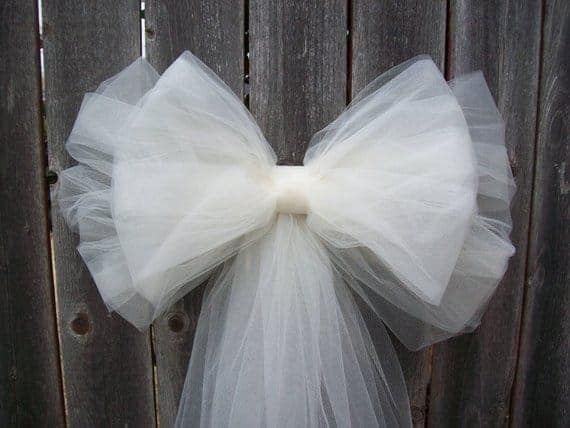 A close look at a white ribbon made of tulle.