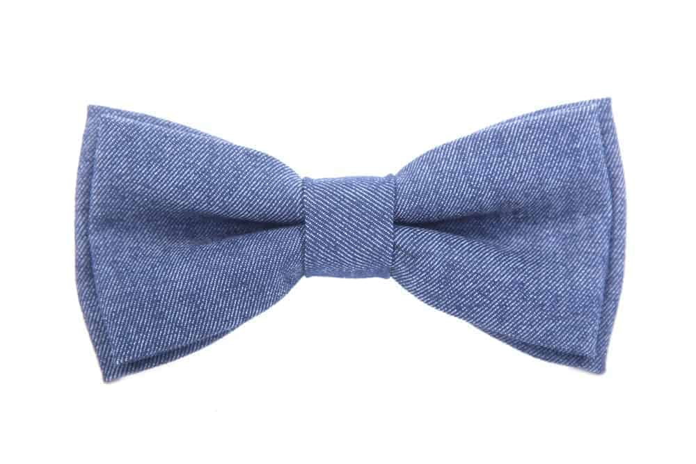 A close look at a gray fabric bow.