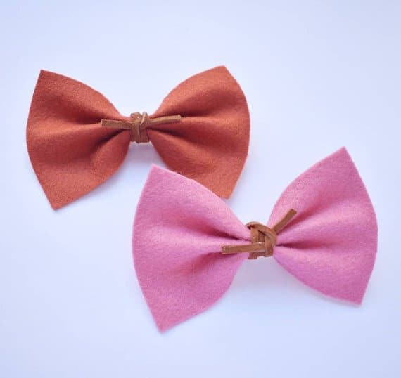 A pair of colorful felt bows.