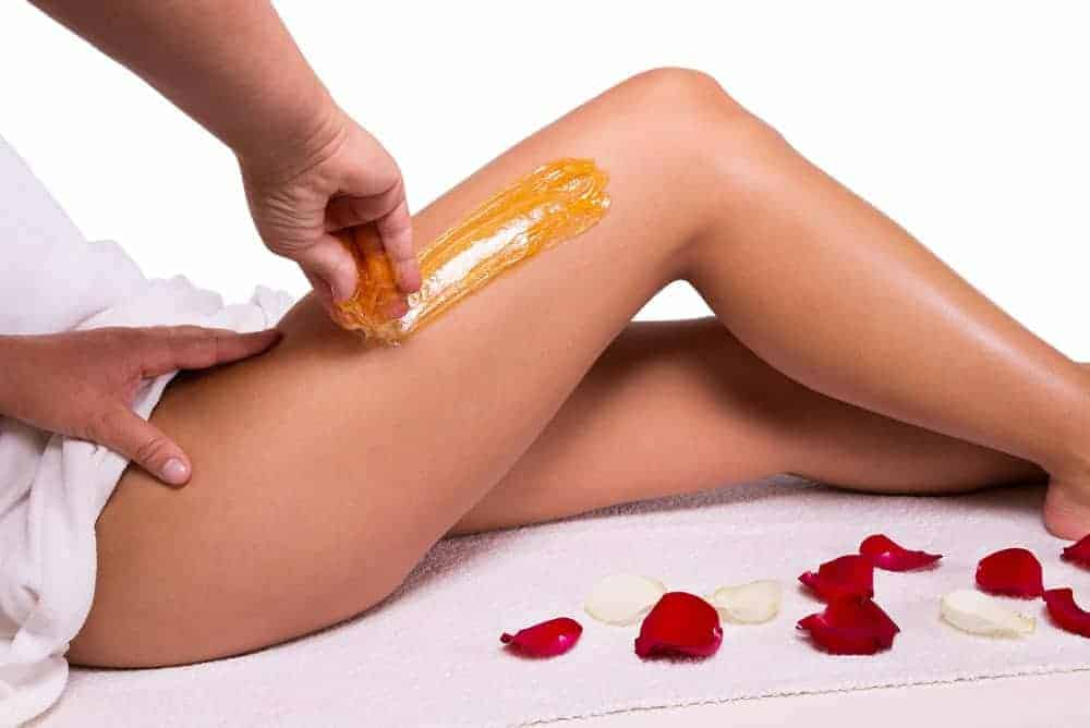 Sugar waxing applied on a woman's hip.