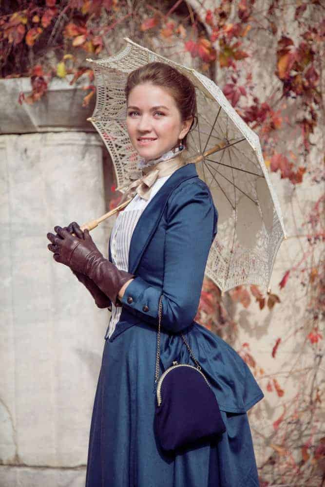Lady in Victorian style with blue purse.