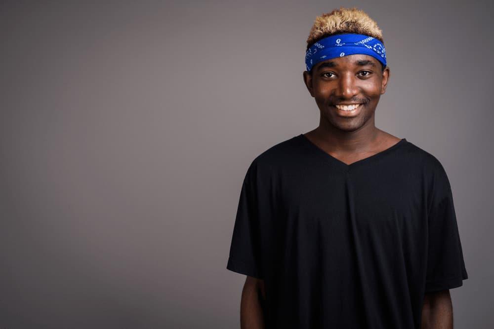 A man wearing a blue patterned headband.