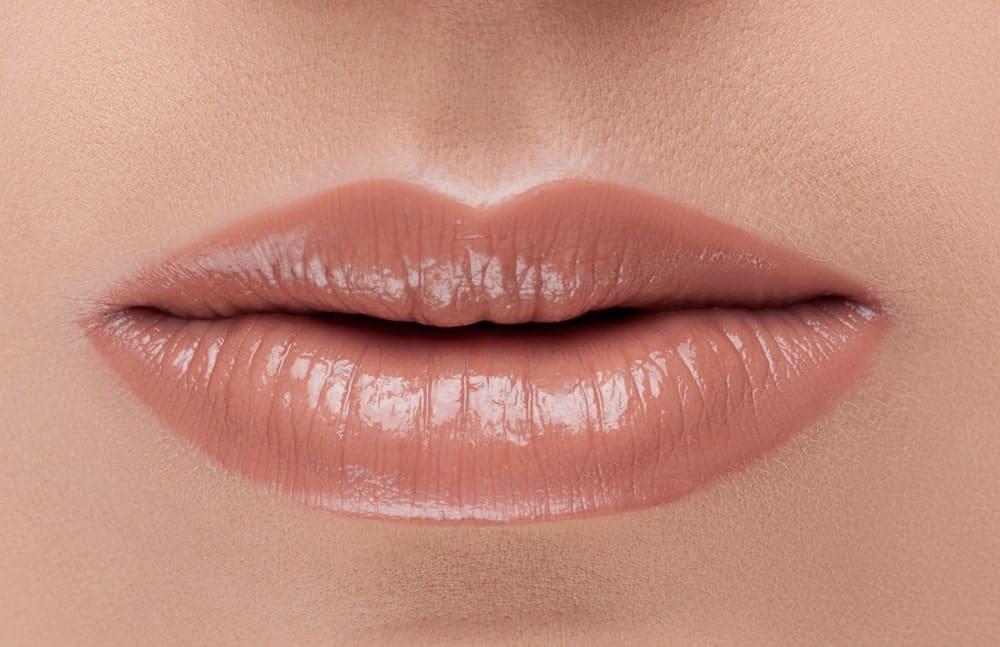 Closeup of sheer lipstick on the lips.