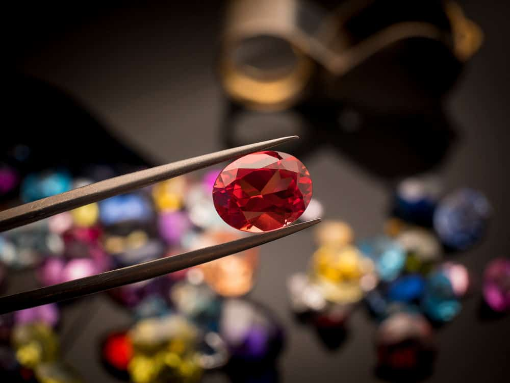 A ruby gem up close held for inspection.