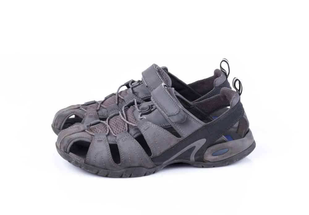 A pair of gray-and-black sports sandal shoe.
