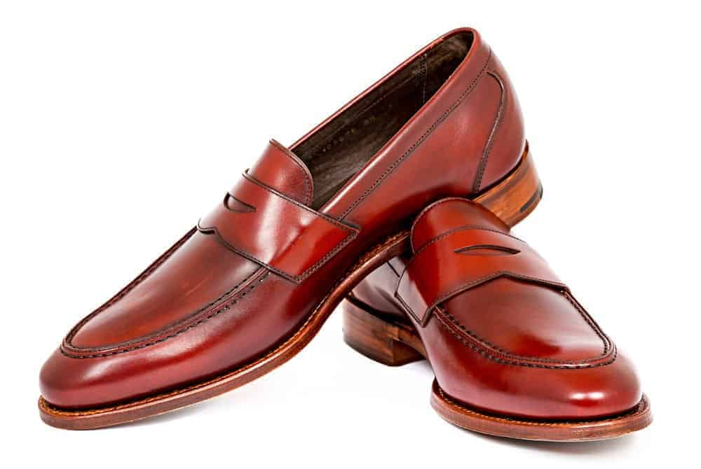 A pair of tan leather penny loafers.