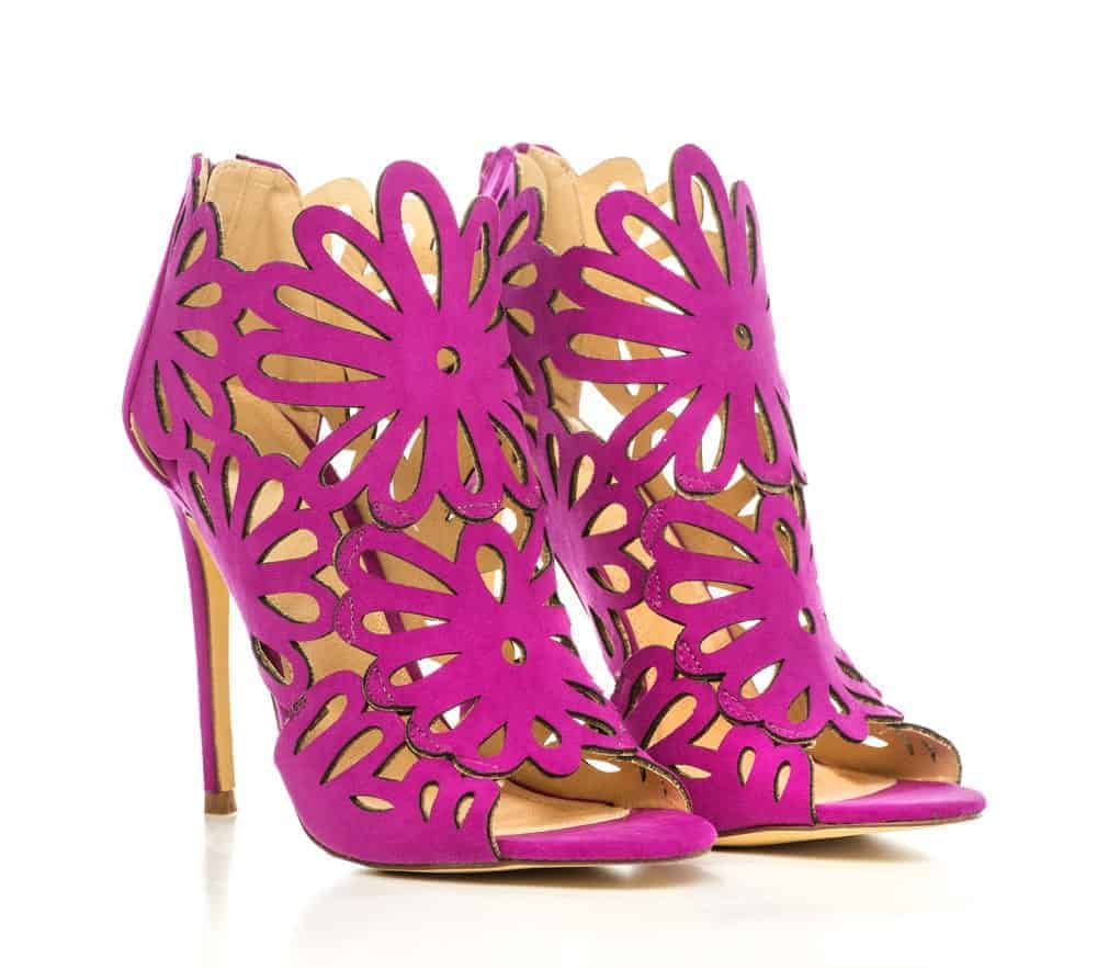 A pair of stylish purple cut out heels.