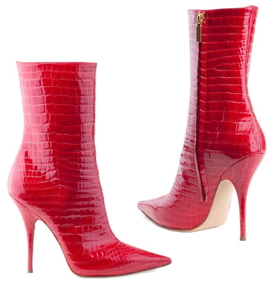 A pair of sexy red leather zip-up boots.