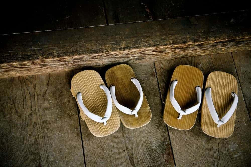 Two pairs of wood sandals.