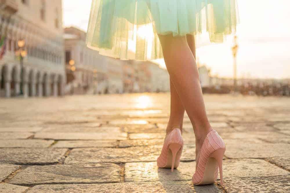 A woman wearing gorgeous heels.